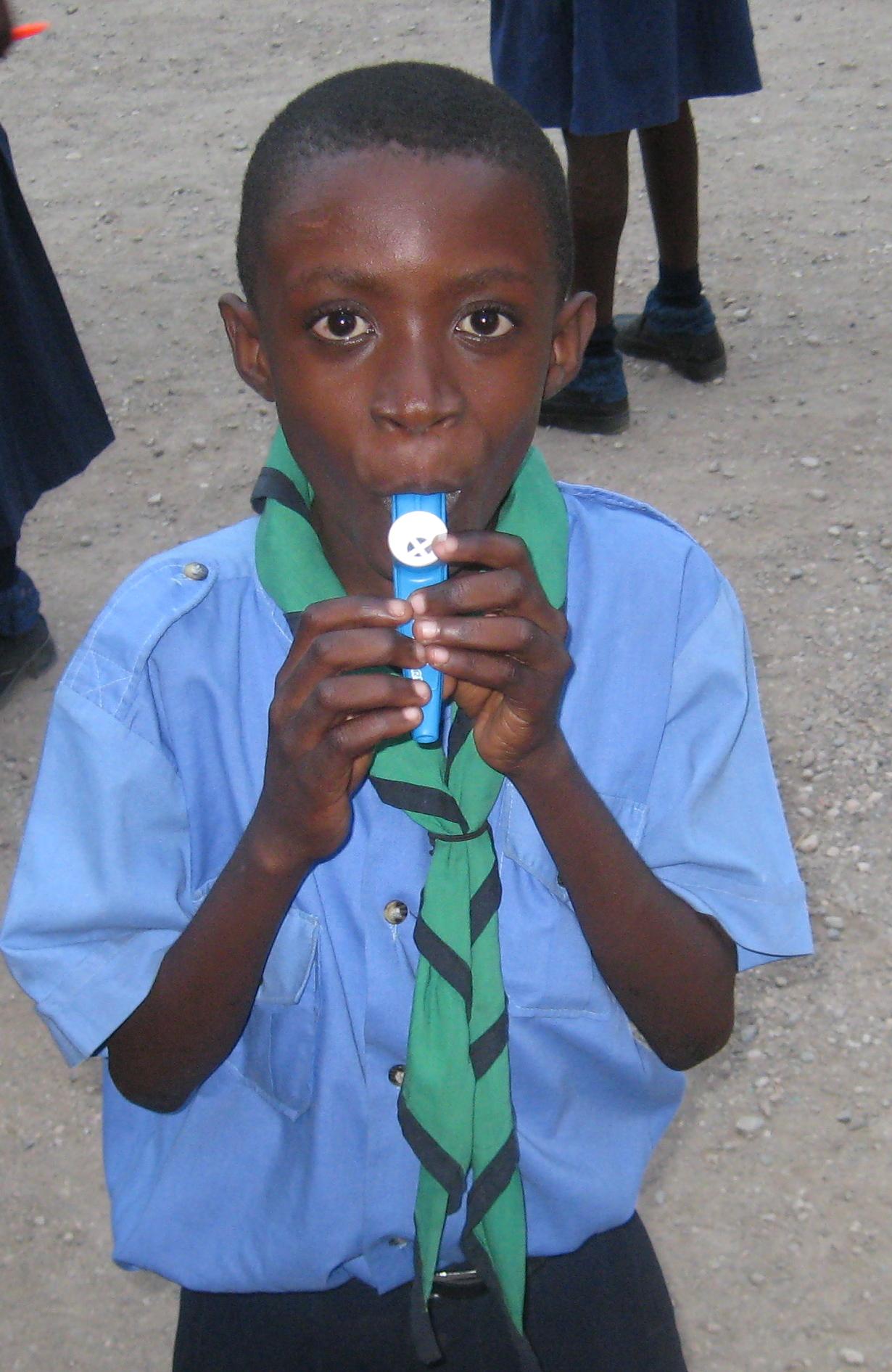 boy playing kazoo